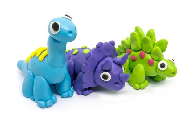 Play dough group brachiosaurus, triceratopson, stegosaurus, on white isolated