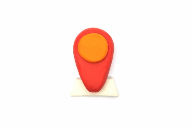 Play dough pin location on white background. handmade clay plasticine