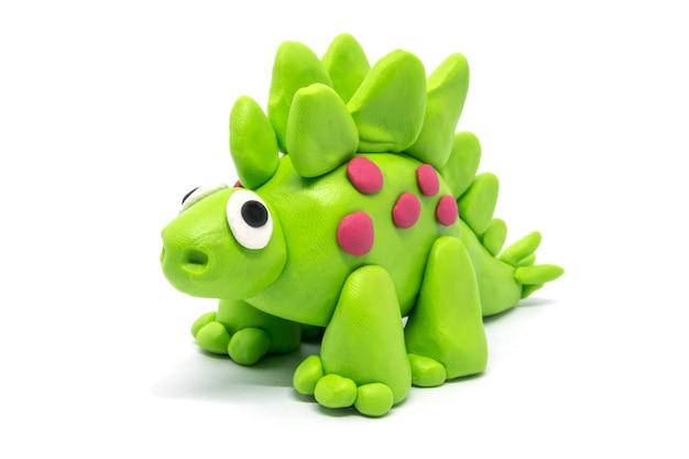 Playdough stegosaurus isolated on white