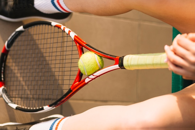 Player holding a tennis racket with a ball in it