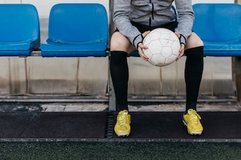 Player on bench holding ball