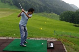 Player practicing golf, activity