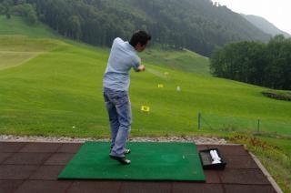 Player practicing golf, practice