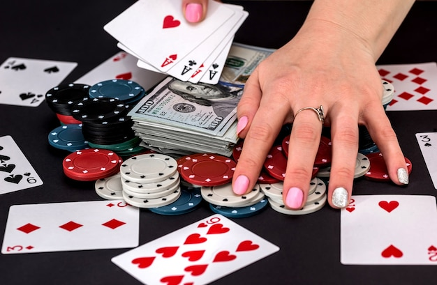 Player with chips, cards and money