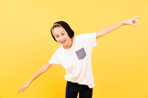 Playful boy wirh arms like airplane flying