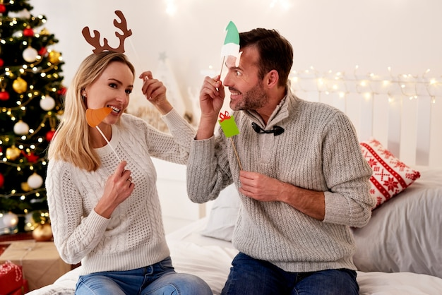 Playful couple in christmas masks
