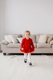 Playful energetic little girl posing in the studio