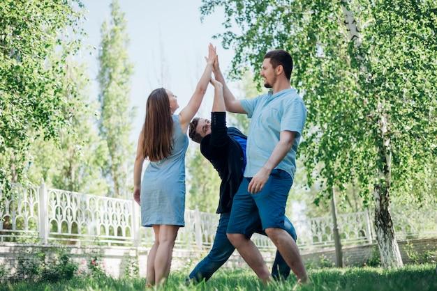 Playful friends giving high five