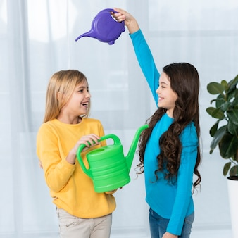 Playful girls watering each other