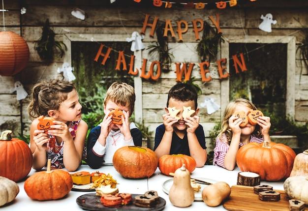 Playful kids enjoying a halloween party