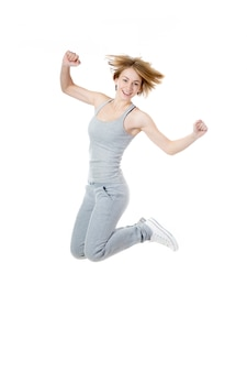 Playful sportswoman jumping