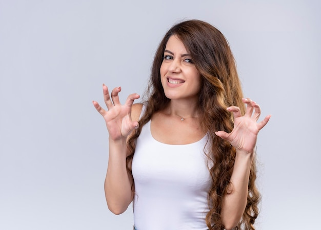 Playful young beautiful girl doing tiger paws gesture  with copy space