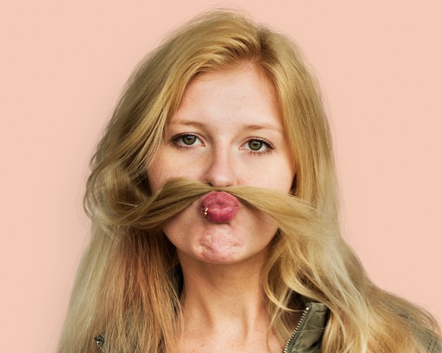 Playful young woman, beautiful face portrait