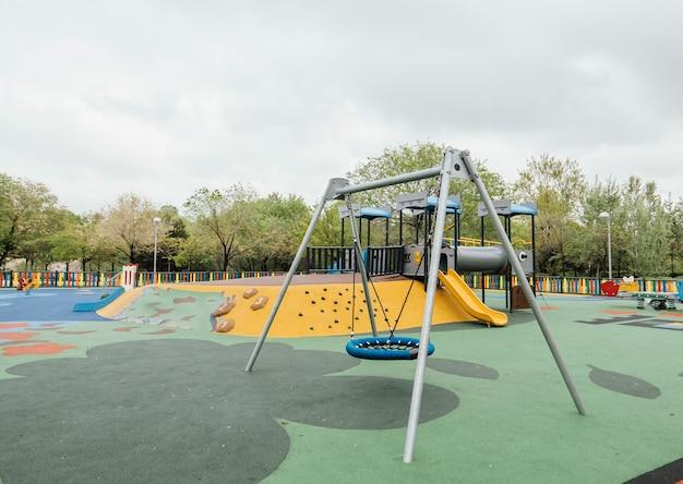 Playground for children in green garden area