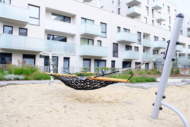 Playground with a hammock close-up in cozy courtyard of modern residential district.