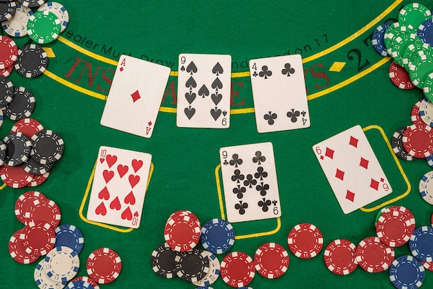 Playing cards and casino poker chips on green table. blackjack