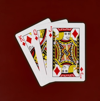 Playing cards king queen jack deck with red background casino poker