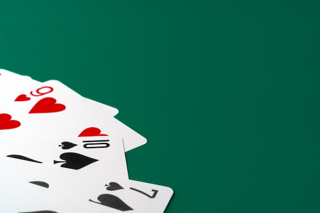 Playing cards on paper background close up