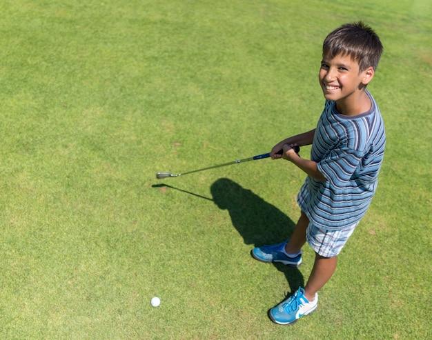 Playing golf at club