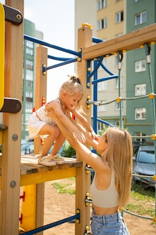 Playing mom and daughter on the playground
