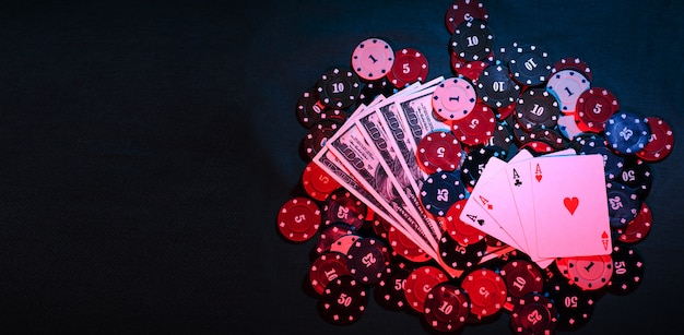 Playing poker chips, cards and smoke-filled money