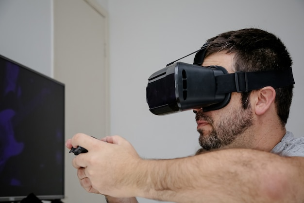 Playing video game in virtual reality with control