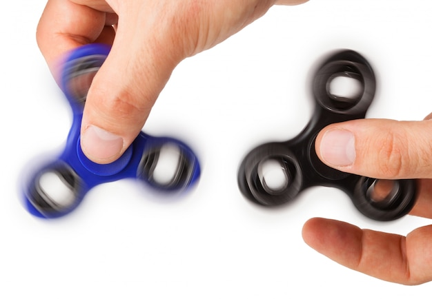 Playing with two fidget spinner
