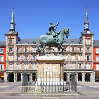 Plaza mayor with statue of king philip iii (created in 1616) in madrid, spain