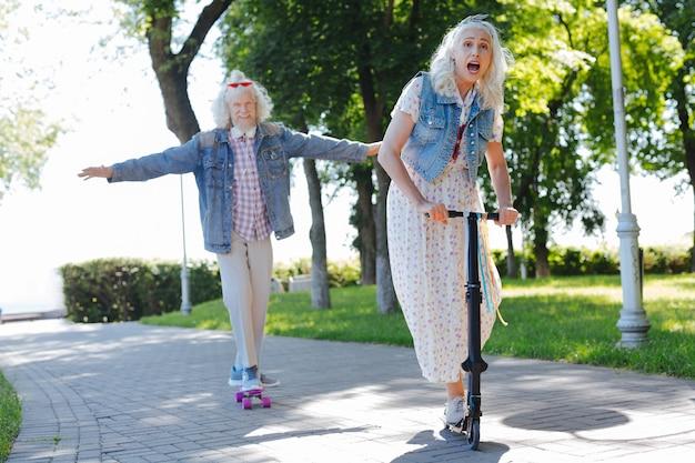 Pleasant activities. joyful elderly people having fun while spending time in the park