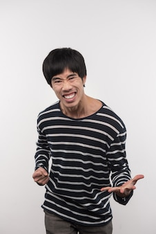 Pleasant emotions. delighted asian man looking at you while feeling happy