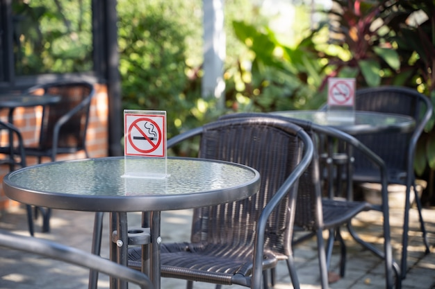 Please stop smoking concept no smoking sign in the coffee shop go free smoking area