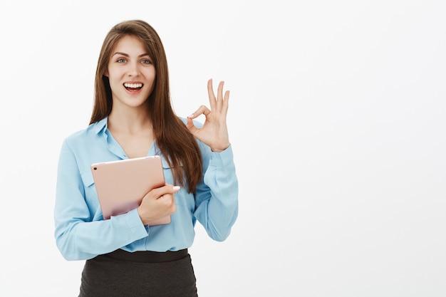 Pleased brunette businesswoman posing in the studio