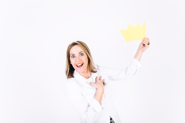 Pleased woman with paper crown
