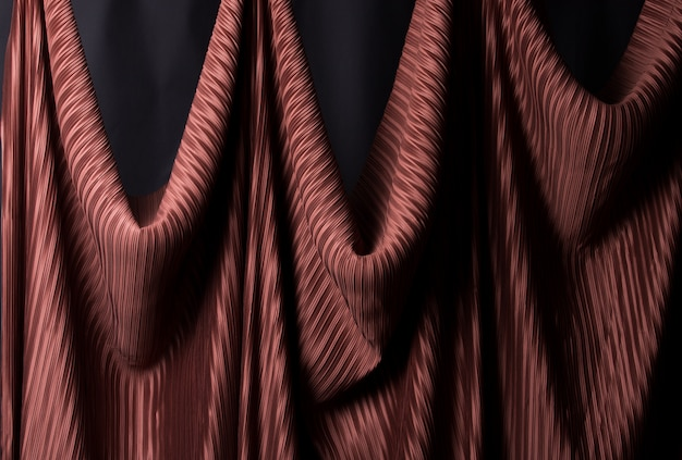 Pleated fabric in long line drape with shadow