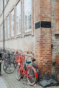 Plenty of bicycles on cobbled street