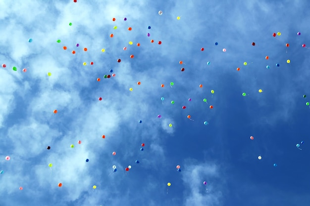 Plenty of multicolored balloons in the blue sky