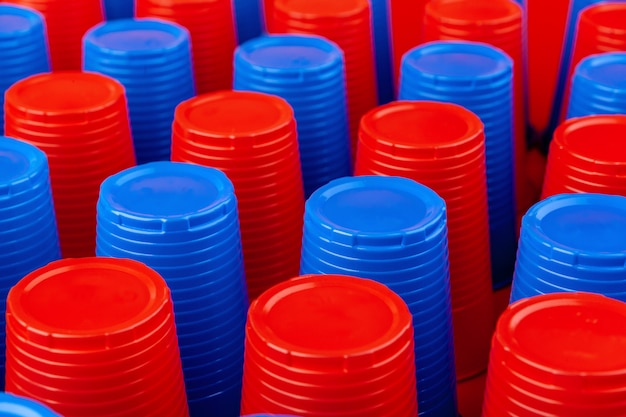 Plenty of plastic empty colorful cups close up