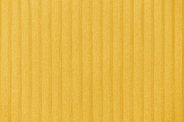 Плиссированный фон. геометрические линии ткани. ткань, текстиль крупным планом, тонированное в fortuna gold.