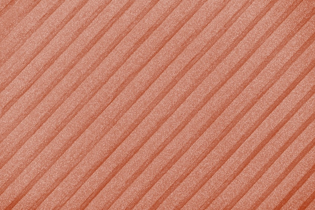 Plisse background toned in brown color. geometric cloth lines. fabric, textile close up.