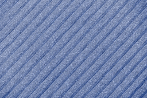Plisse background toned in  classic blue, faded denim. geometric cloth lines. fabric, textile close up.
