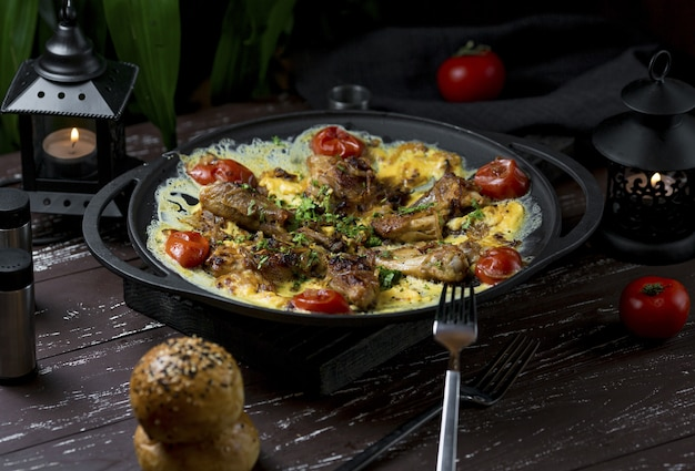 Plov, spicy rice garnish with chicken legs and herbs