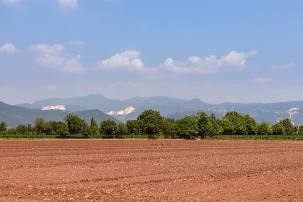 Plowed field. field prepared for crops. spring time in nord italy