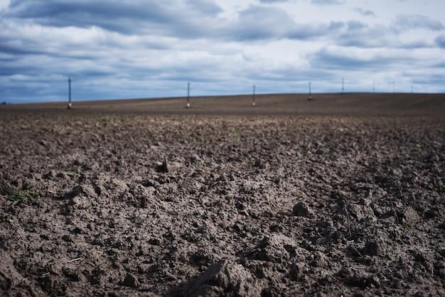 Plowed field in spring day.