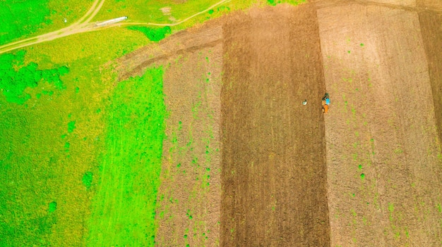 Plowed land to prepare for agricultural crops with tractor.