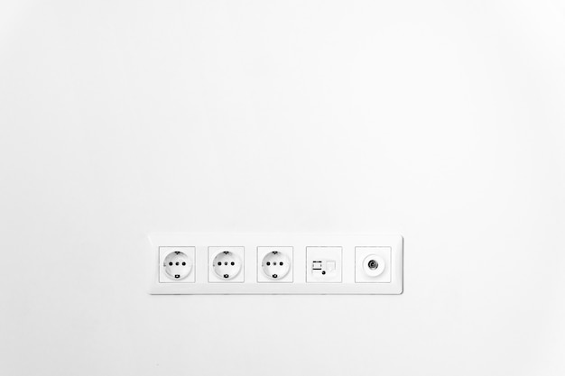 Plug socket in wall close up. tv set. white wall. copy space