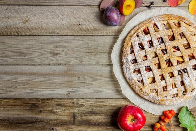 Plum apple pie. cooking. recipes. vegetarian food.