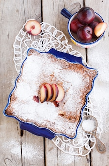 Plum cake in the shape  with powdered sugar