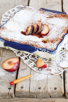 Plum cake in the shape  with powdered sugar.