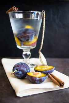 Plum lemonade glass on tablecloth