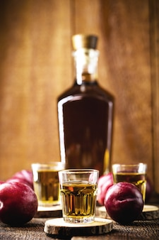 Plum liqueur, alcoholic drink with traditional plum from the middle east and asia